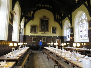 Interior of the main hall of Oriel College, Oxford, with the tables set for lunch.